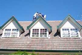Roof impressions cleaning and repairing a house in Sydney